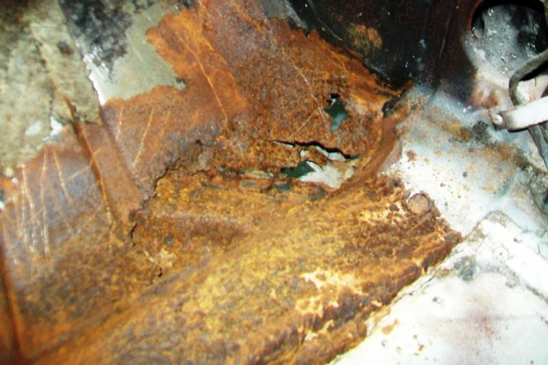 Passenger side toe board and floor pan rust. The cuprit here was a leaky heater core unit that went unattended to, lord knows how long, prior to mee aquiring the car. I found it odd that a square of the oringinal carpet was cut out, but under a makeshift piece of carpet was a home made patch in the floorpan.