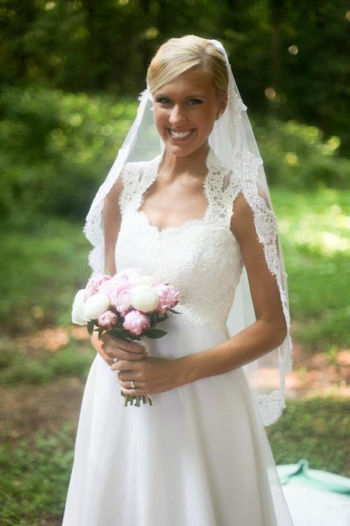 This bride chose to wear her mother's veil on her big day.    hoto by Bradley Quinn