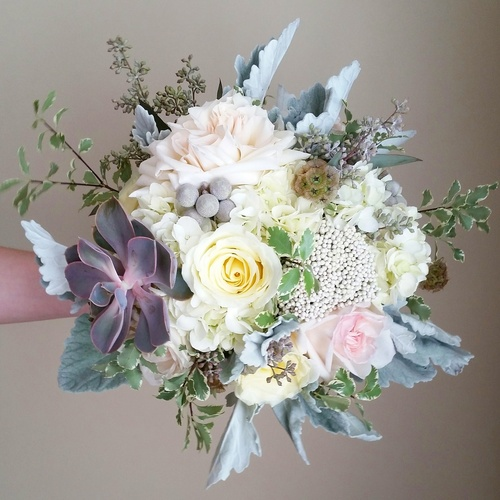 A gorgeous bouquet designed by Anna Passarelli of Simply Elegant Floral Designs with hints of blue.