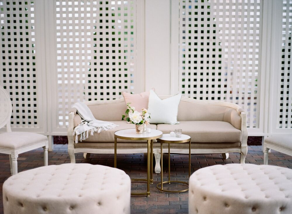 Cottage Luxe  East Lake English Roll Arm Sofa and Emily Tufted Ottomans made for the perfect lounge area in the pergola.