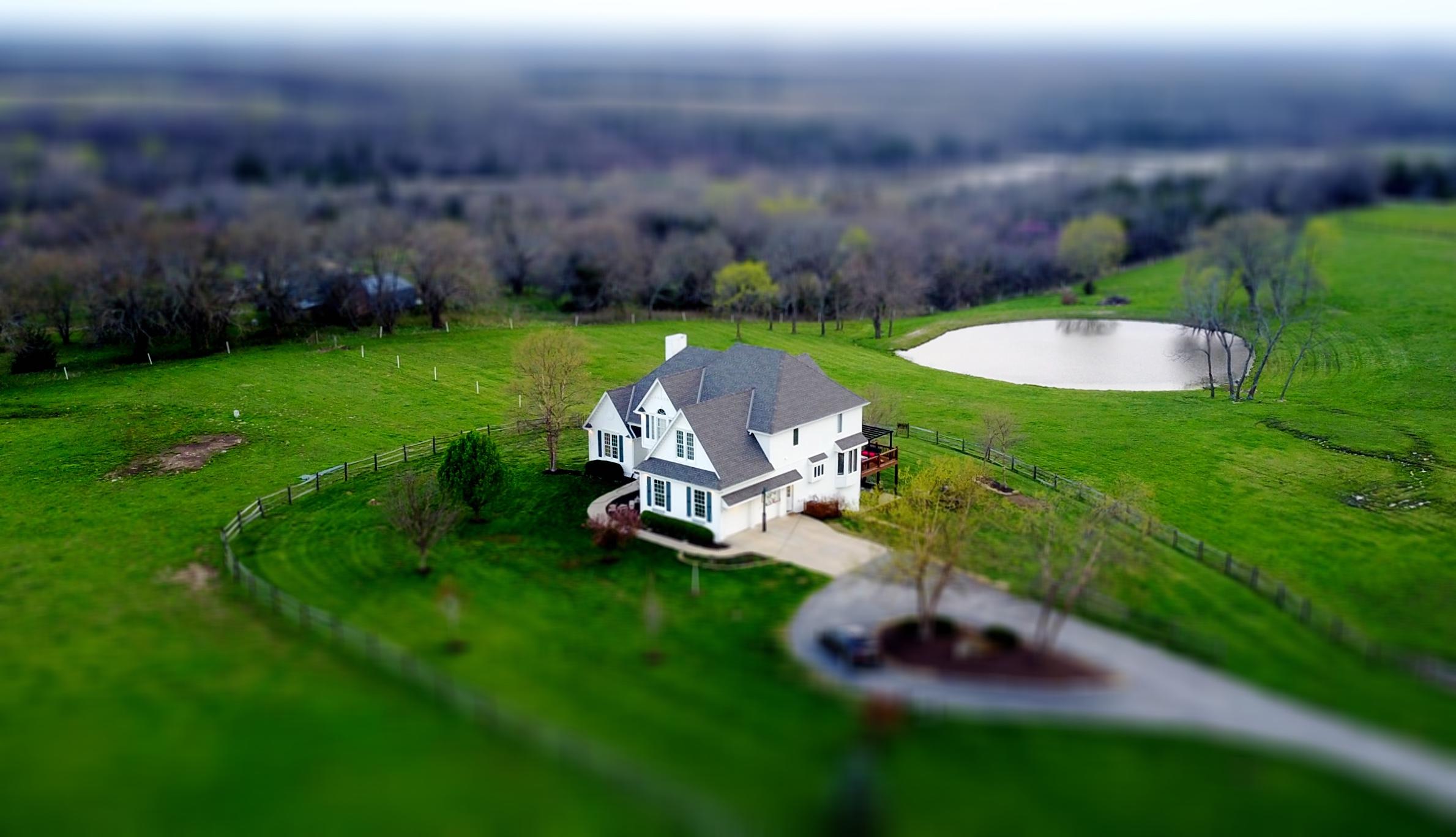 house home tilt shift green grass.jpeg
