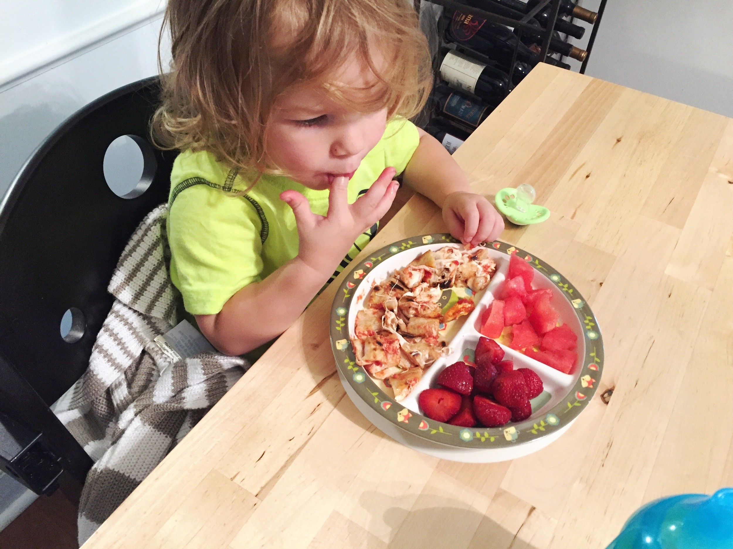A rare quiet moment- he had his three favorite foods: Pizza, Strawberries, and Watermelon