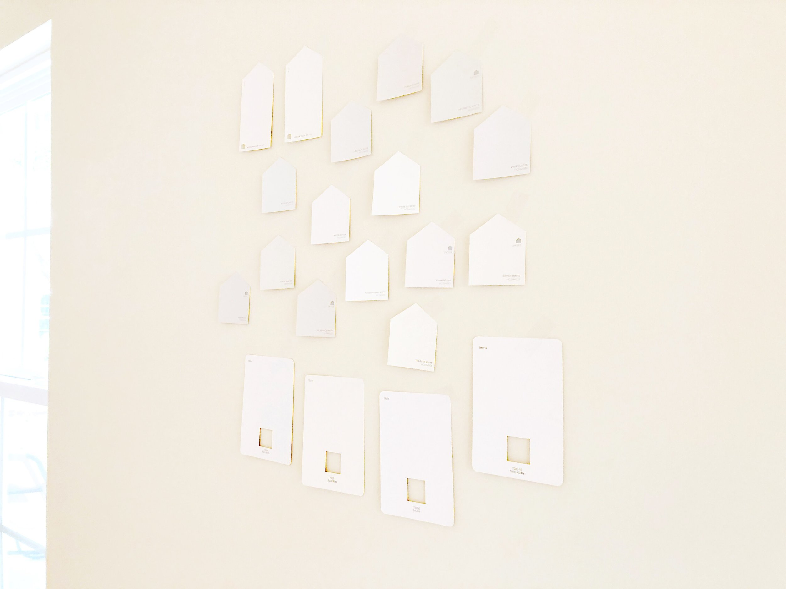 Now that we own the house, it's time to make some more upgrades - like choosing the perfect shade of white paint!