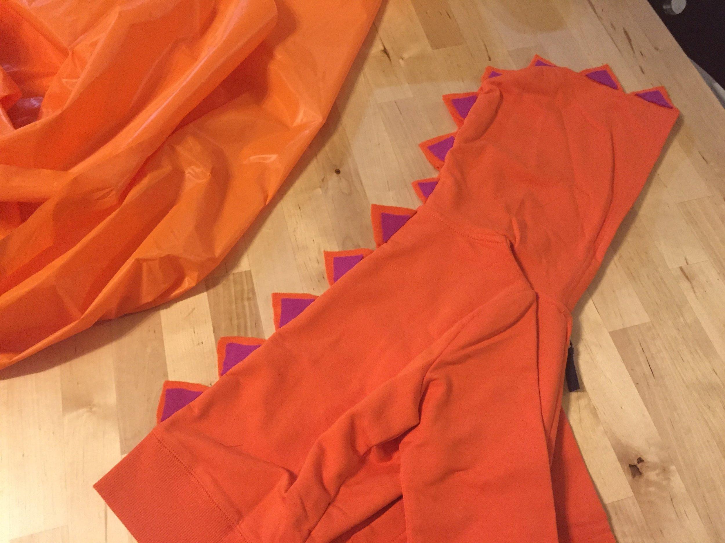 Glue on the accent triangles #halloweendinodiy