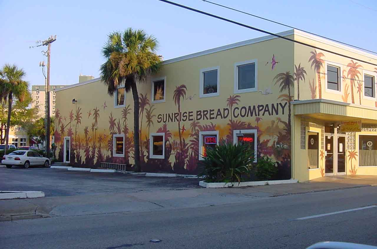 Look for our distinctive mural on our building.