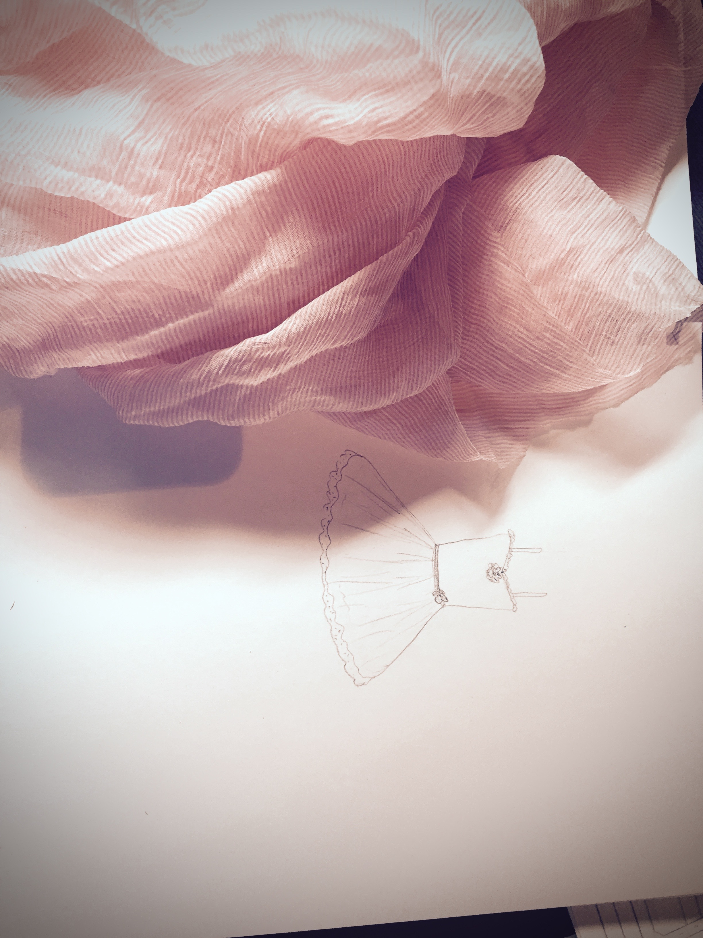 The selected chiffon and sketch of the dress