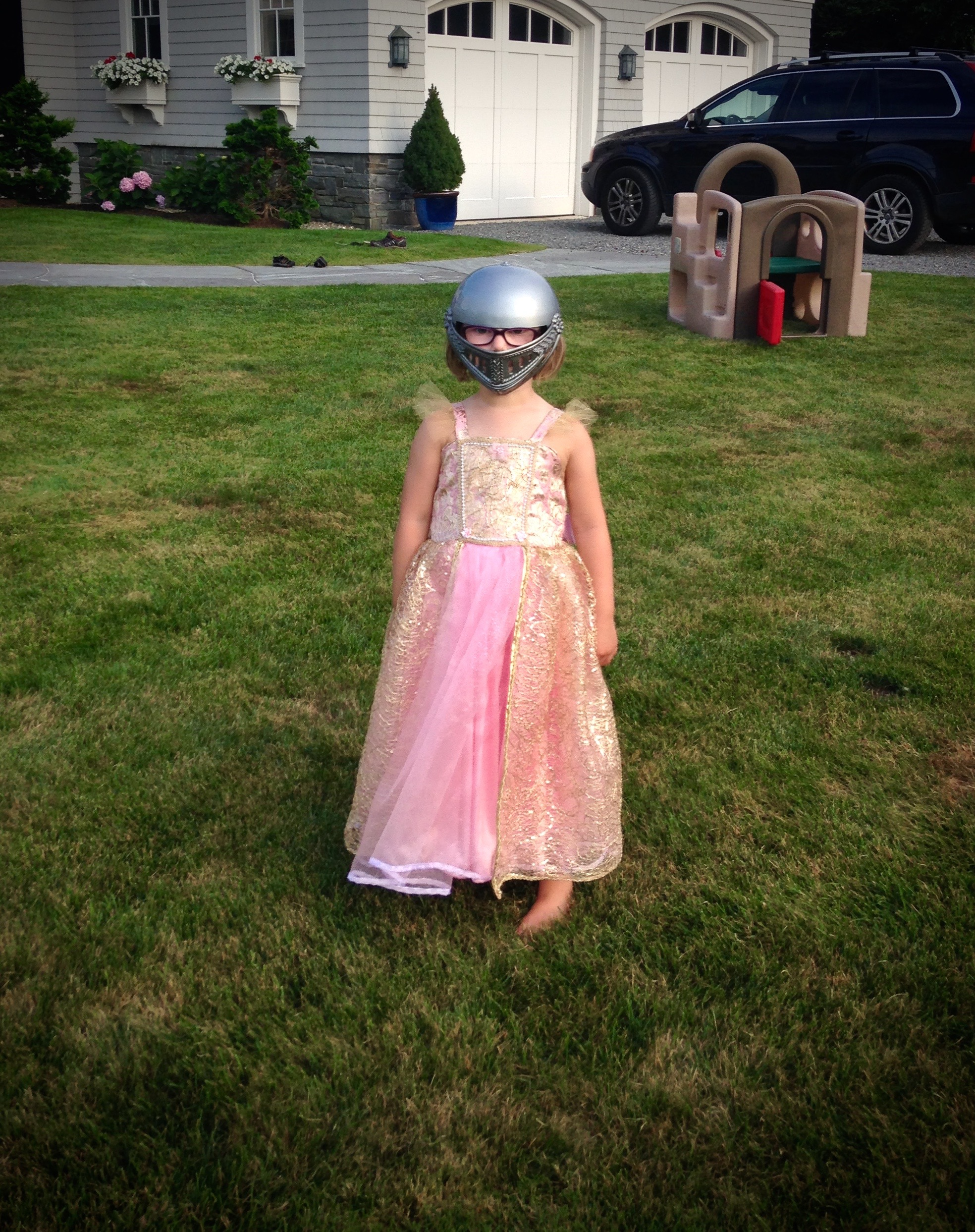 "My daughter in one of my gowns, she quickly stole the helmet from her brother and ran around yelling ""Protect!"", that's my kind of princess!"