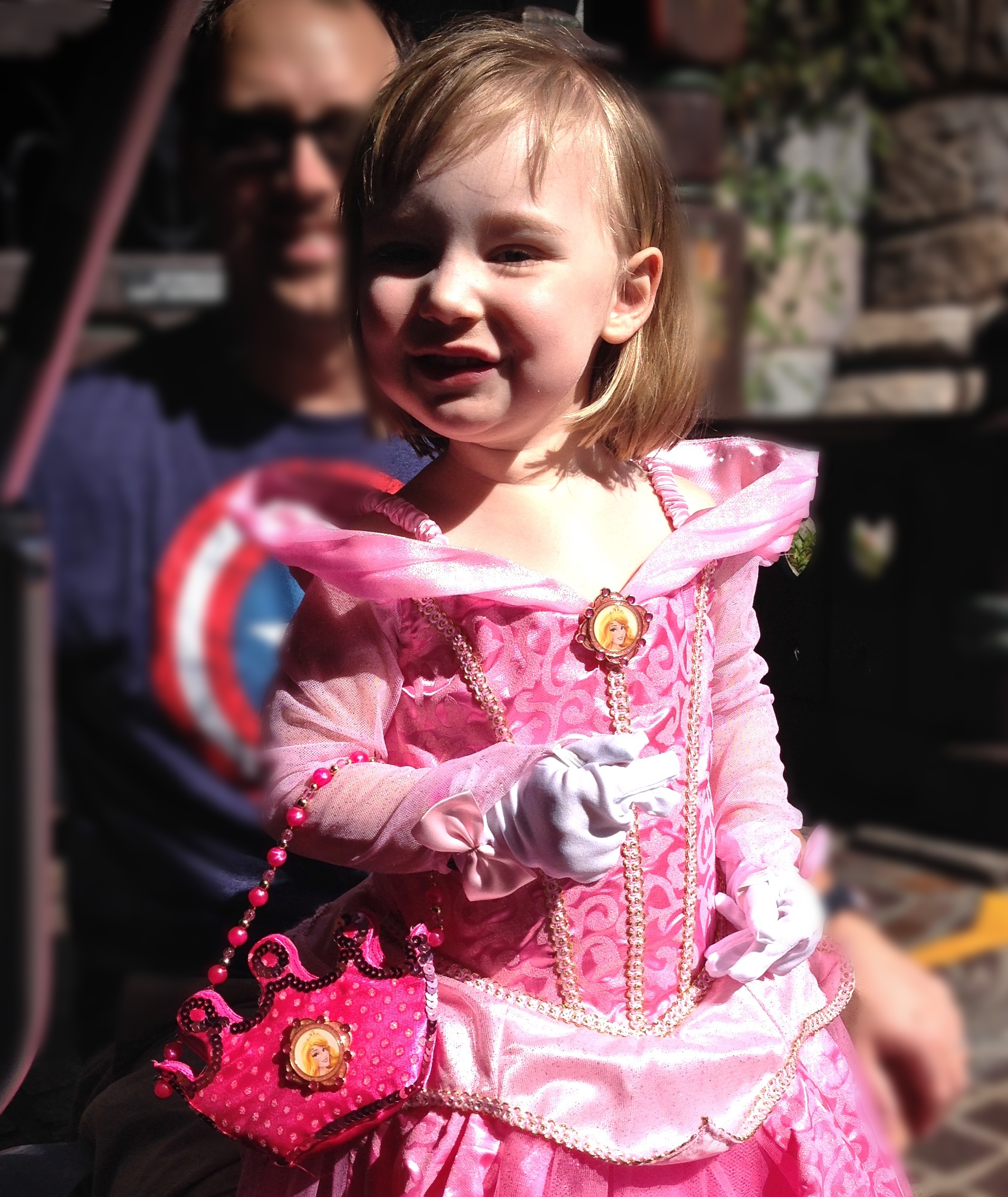 My daughter lit up with joy in her Aurora costume at Disneyland