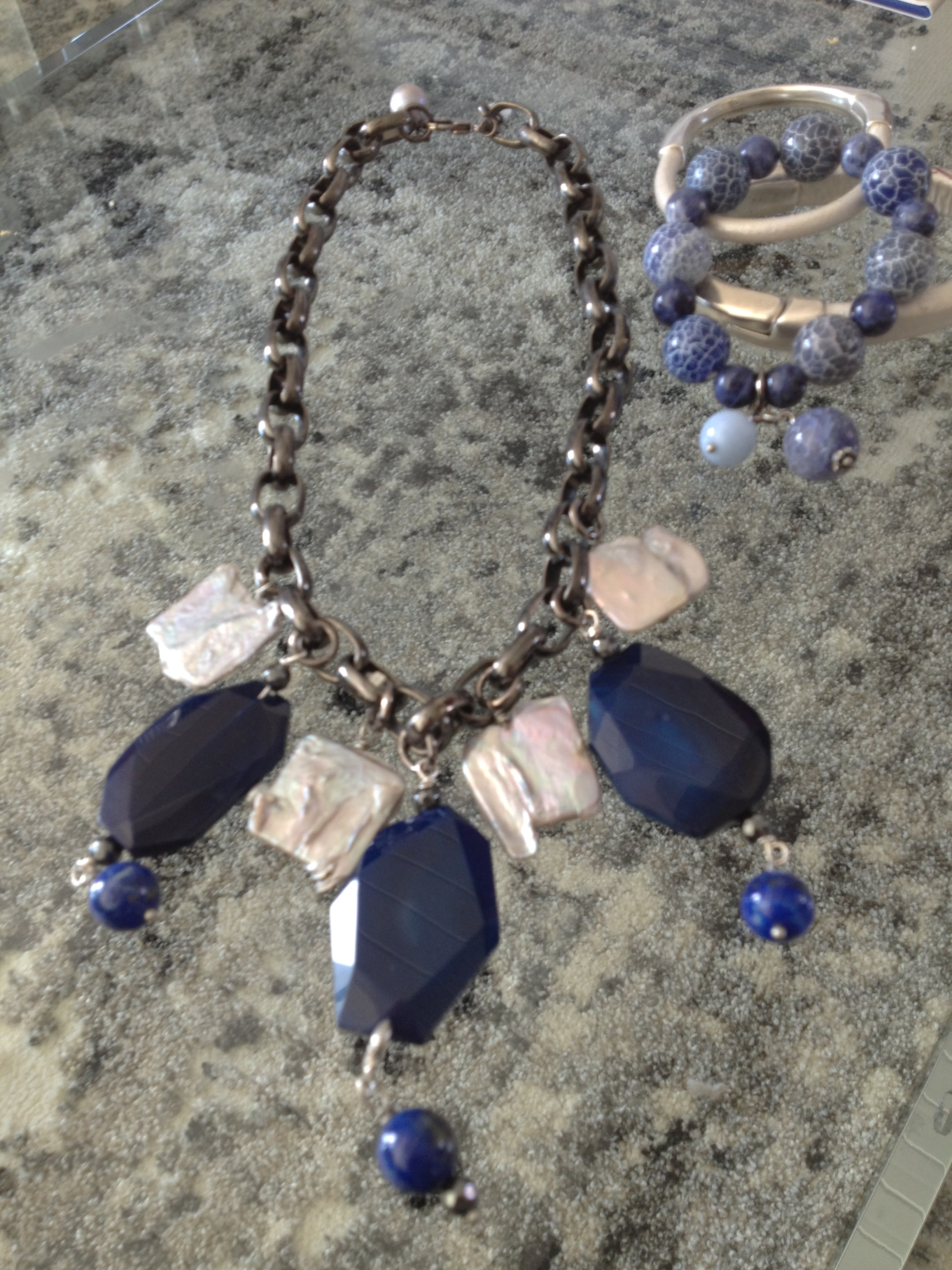 Lapis, agate and pearl necklace on heavy chain Cracked blue ceramic, white jade with rhinestone bracelet Leather and silver bracelets