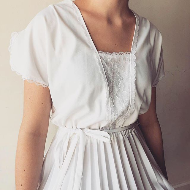"Mood: ""Im sensitive and Id like to stay that way""-Jewel 🕊Vintage White Dress with lace detail & pleated bottom available ~ @parisonponce"