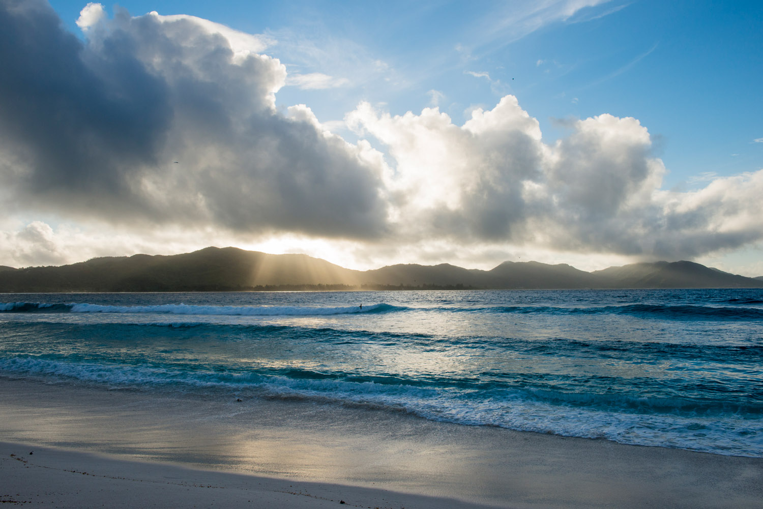 Indian Ocean and Praslin island at dawn, Cousin Island Special Reserve, Seychelles