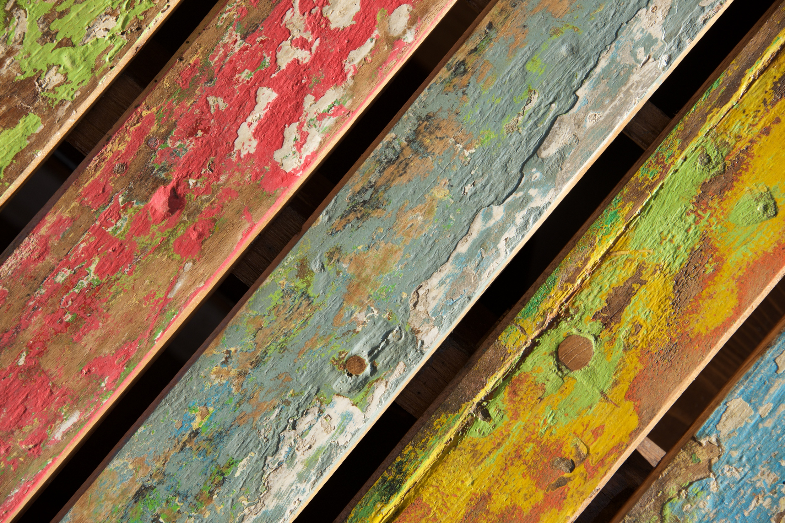 Multicoloured distressed chair back at an angle.jpg