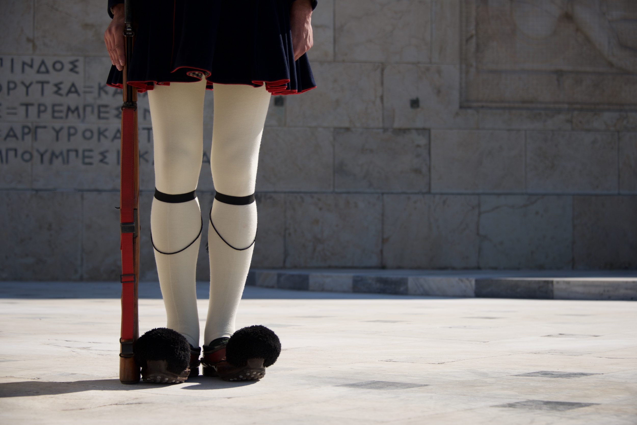 Legs of Greek presidential guardsman with rifle.jpg