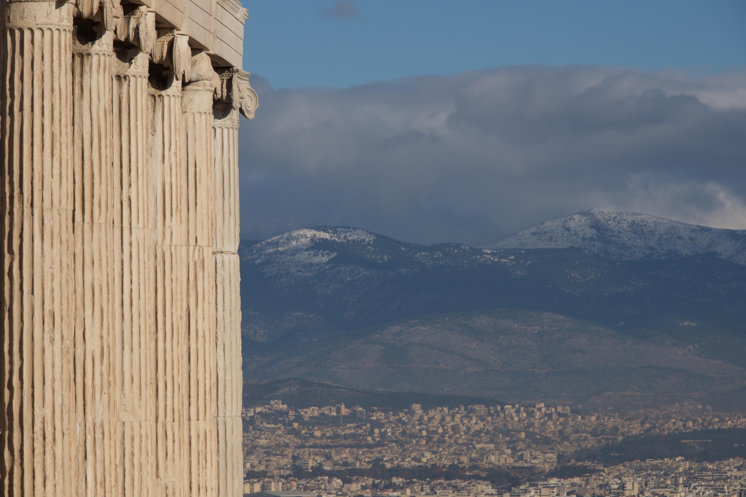 Athens and hills seen beyond Erechtheion colonnade.jpg