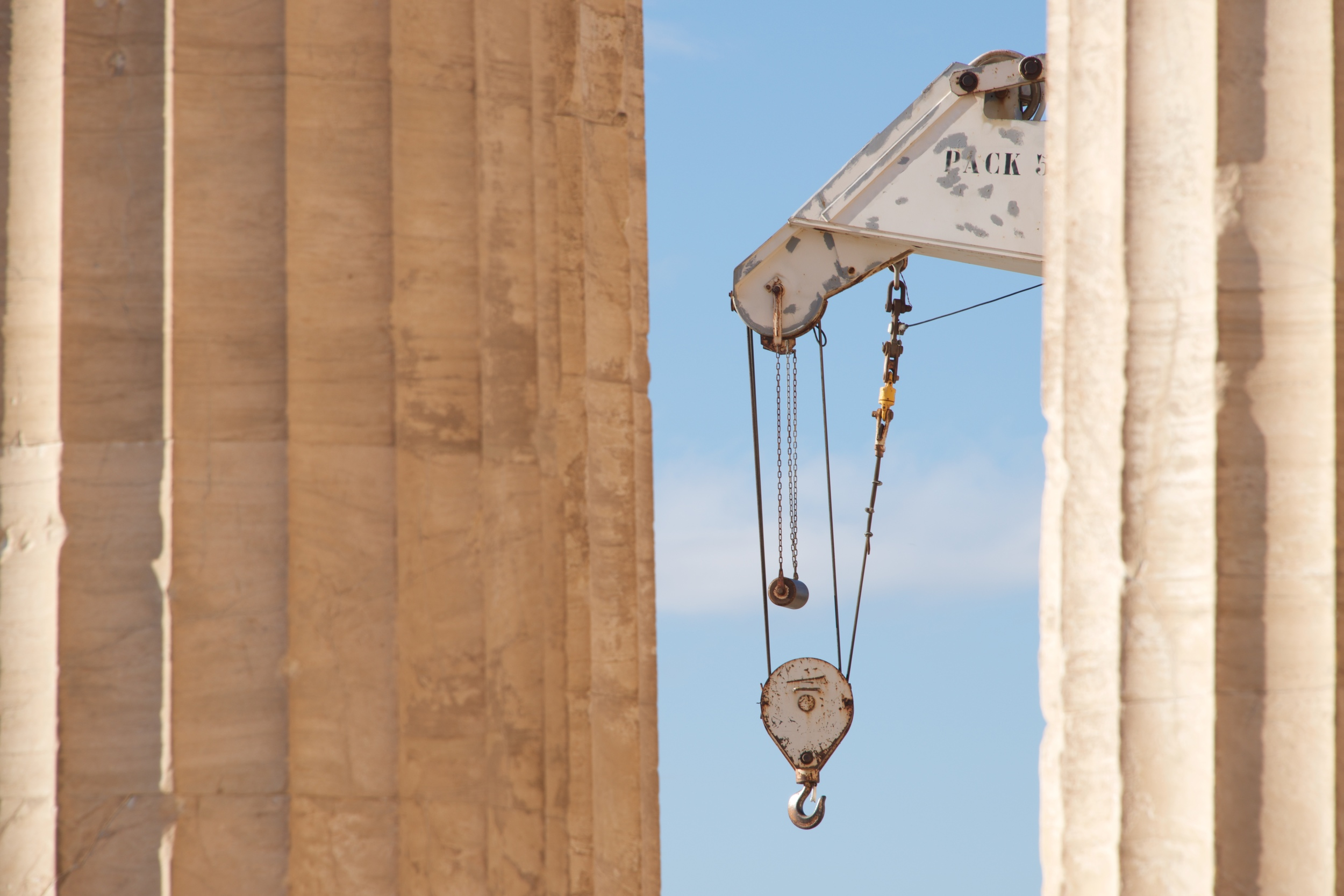 White crane between two marble Parthenon columns.jpg