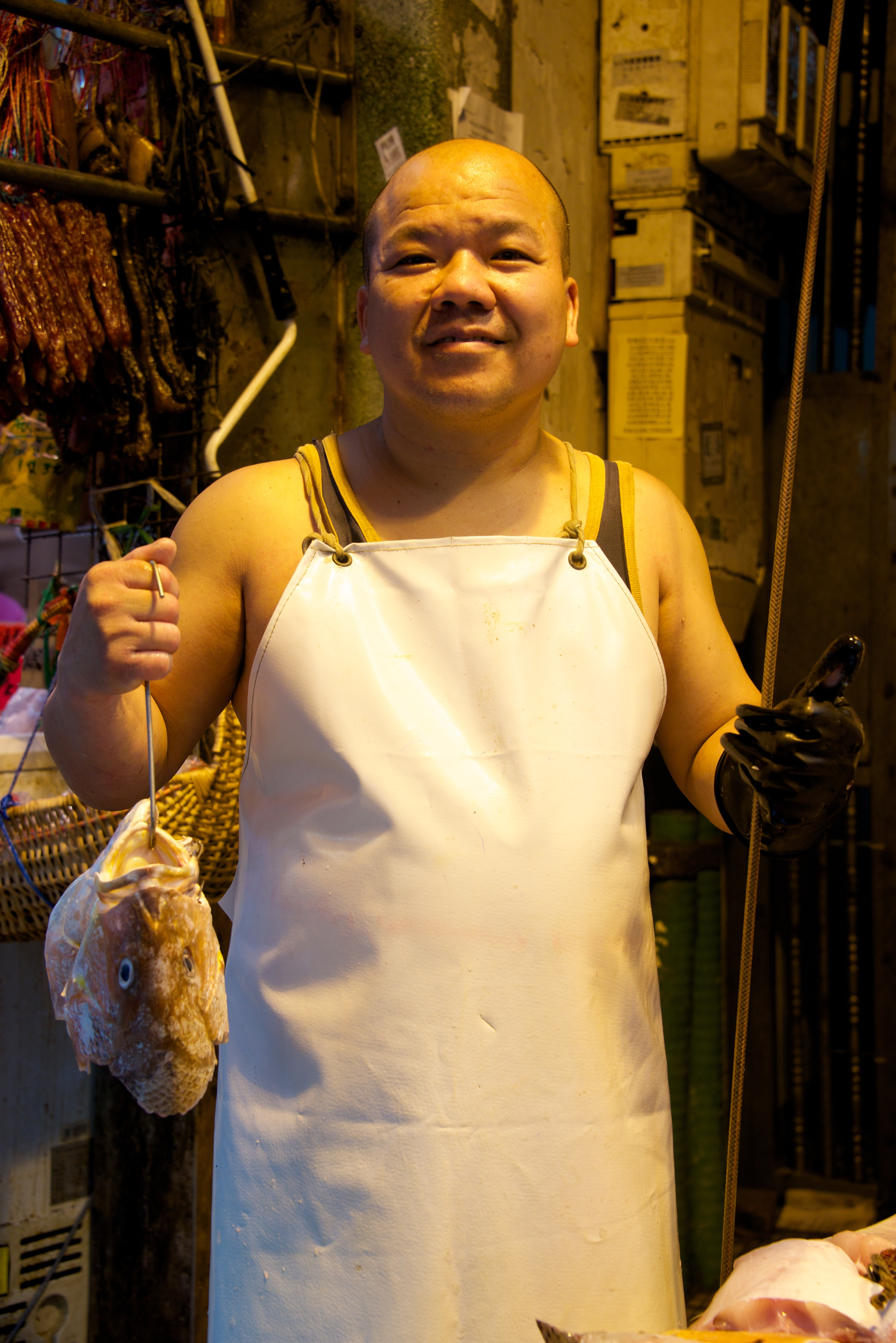 Smiling Chinese fishmonger