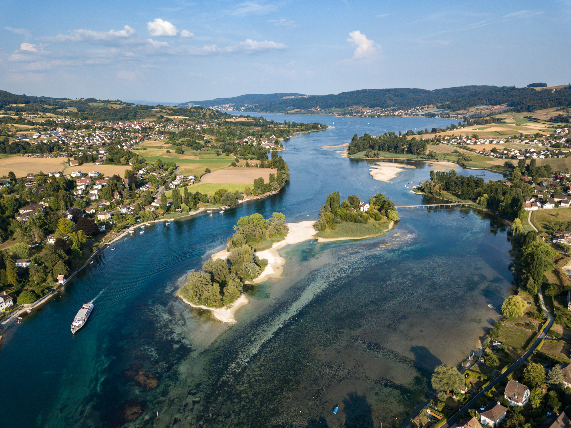 Aerial Drone photography of the beginning part of Rhine river at Lake Constance: Islet Werd, Stein am Rhein, Switzerland
