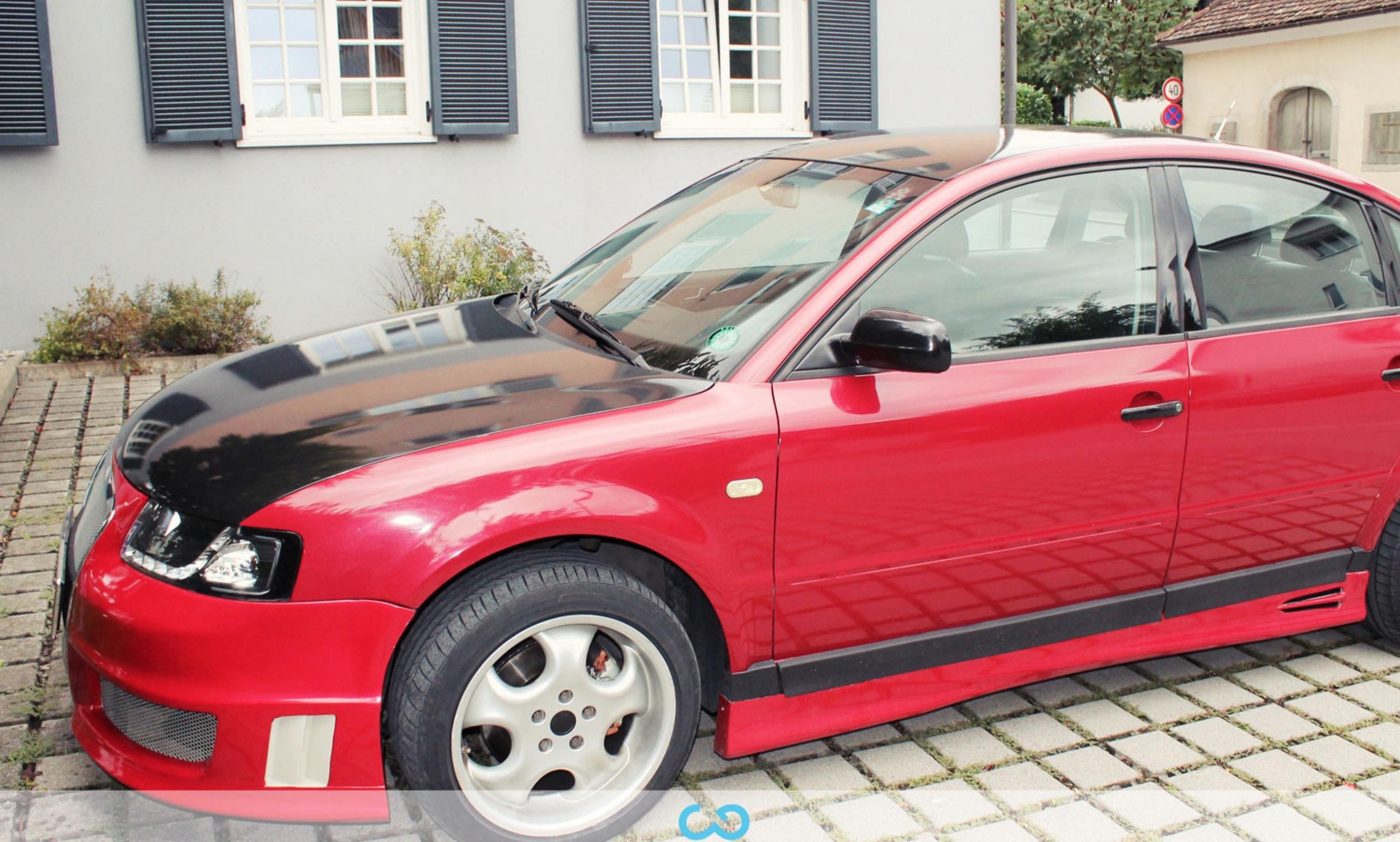 autofolierung-car-wrapping-1-teilfolierung-audi-schwarz-rot-2012-09-01-2.jpg