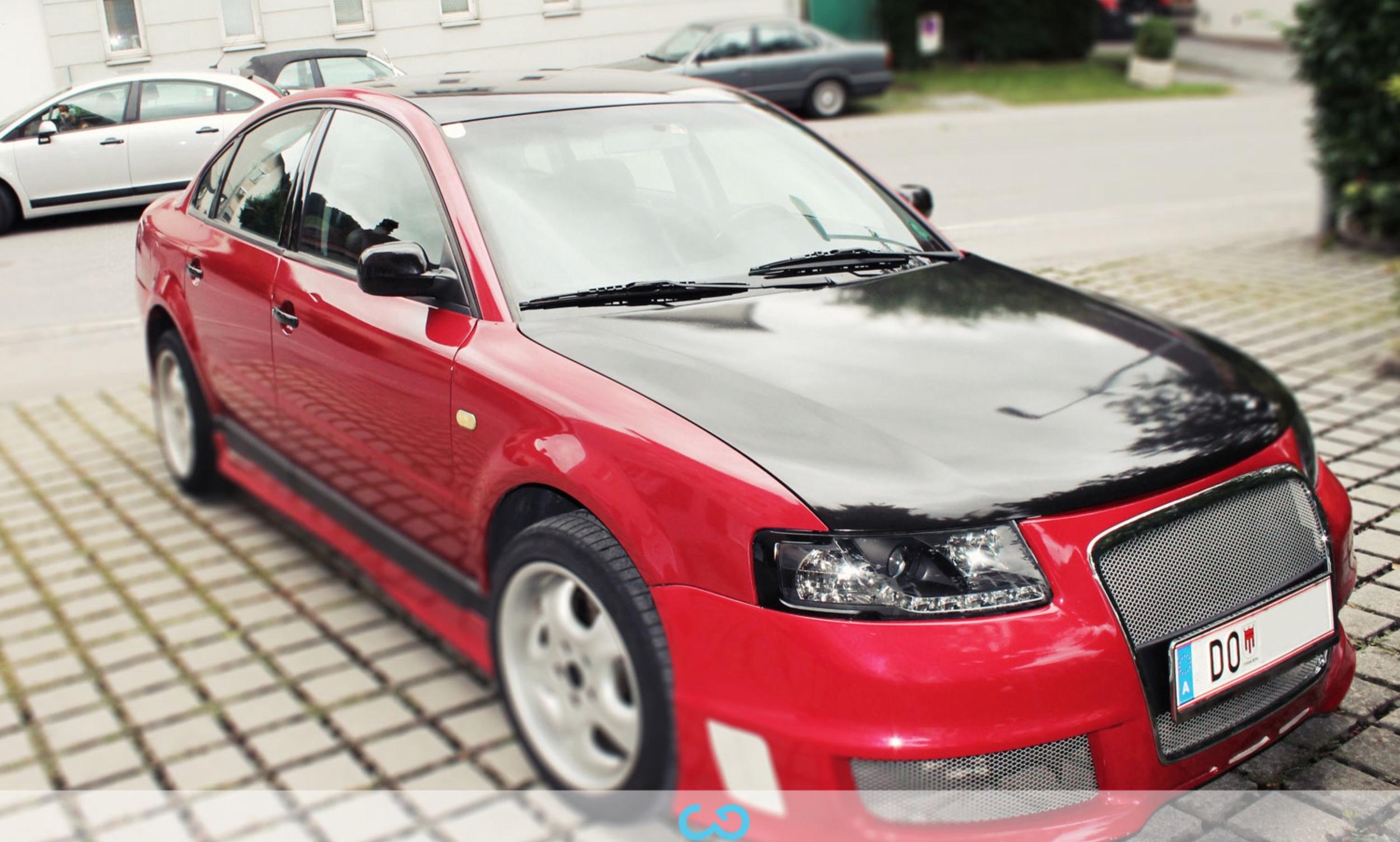 autofolierung-car-wrapping-1-teilfolierung-audi-schwarz-rot-2012-09-01-1.jpg