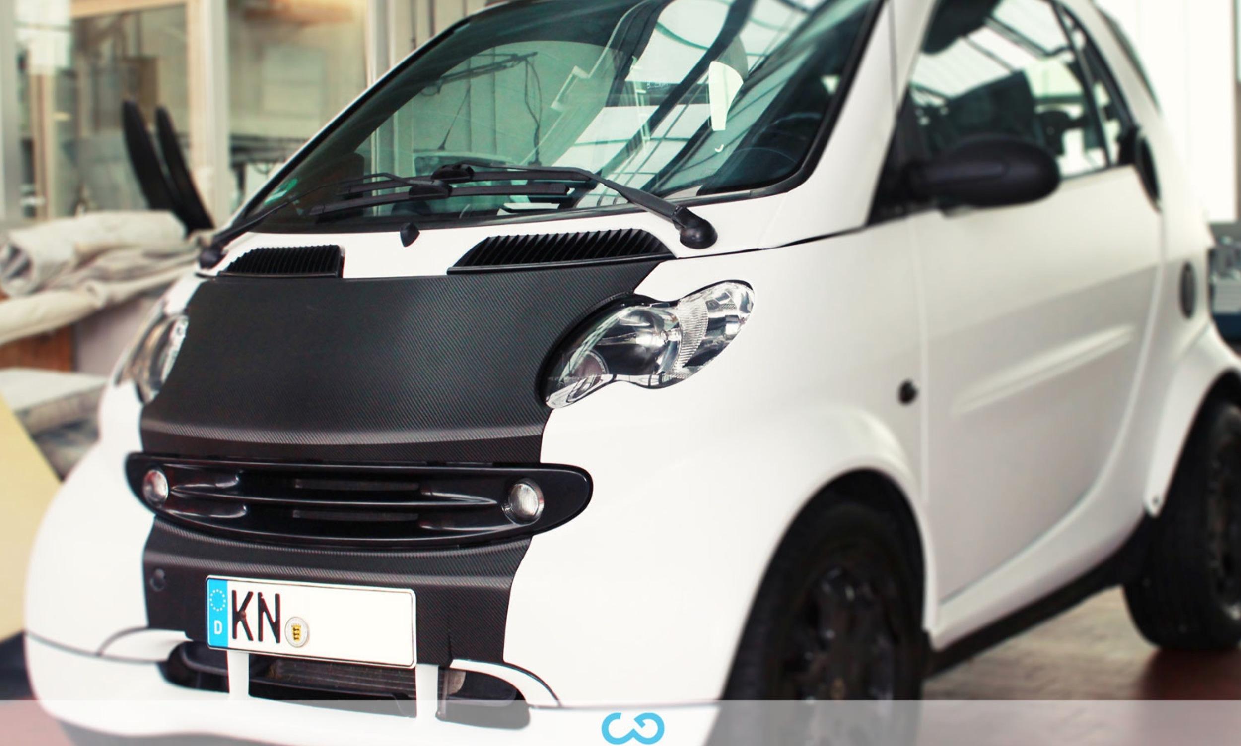 autofolierung-car-wrapping-3-vollfolierung-teilfolierung-carbonfolie-smart-weiss-2012-10-12-3.jpg