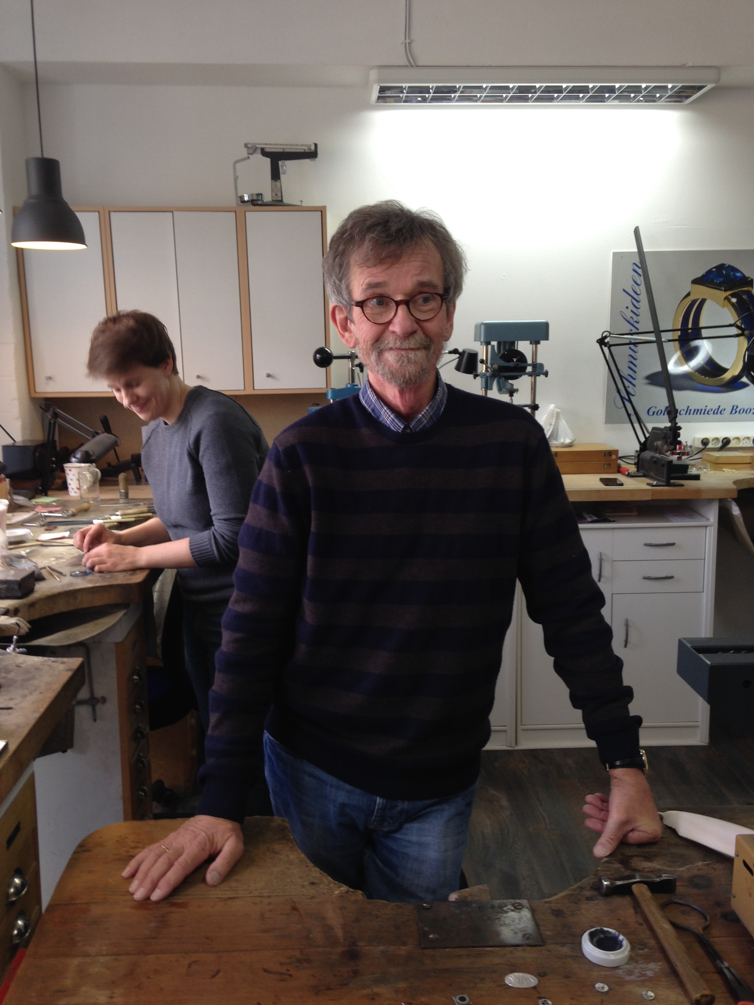 Goldsmith and owner Peter Booz and journey woman Lena Hollweg having fun in the workshop.