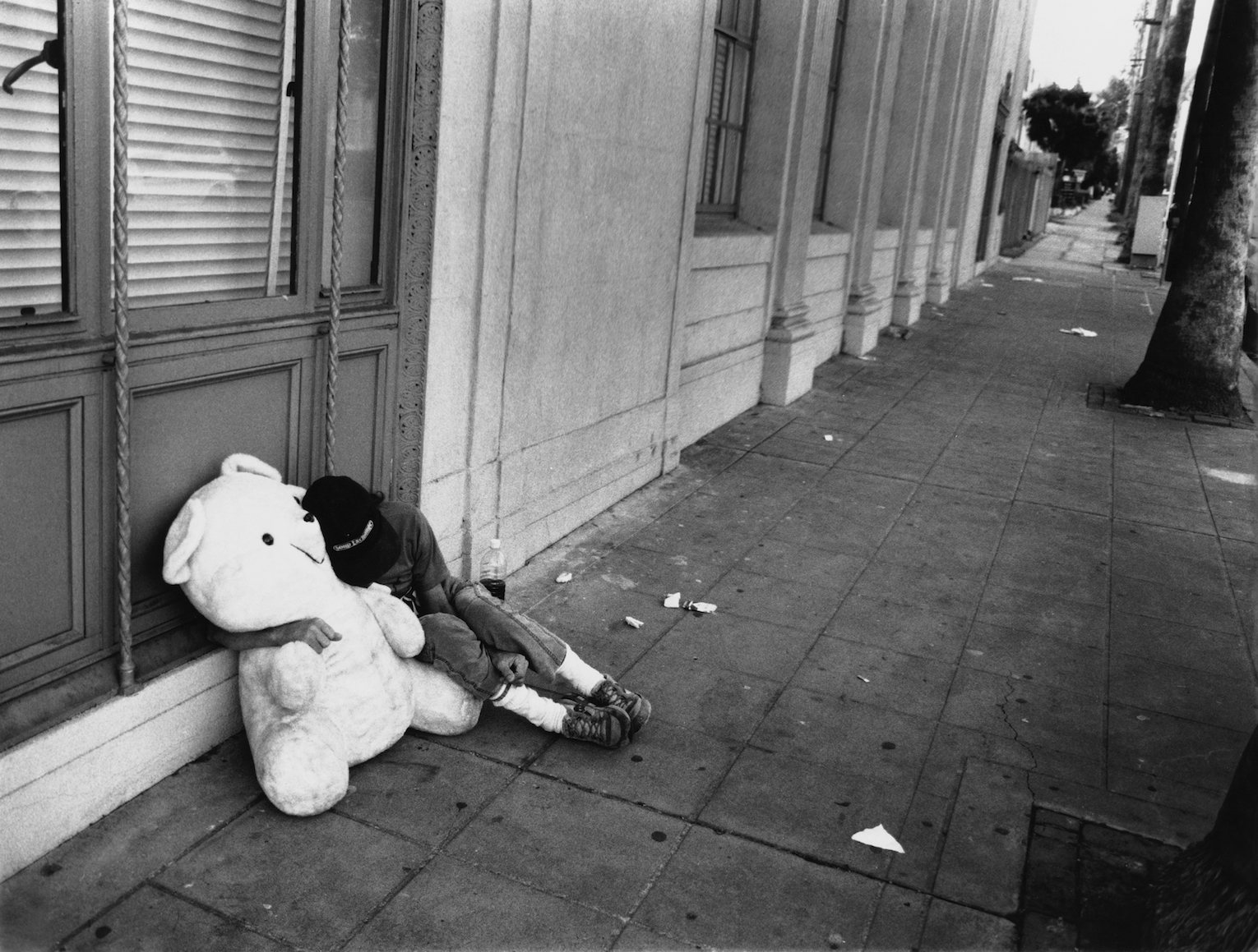 homeless wit teddy bear.jpg