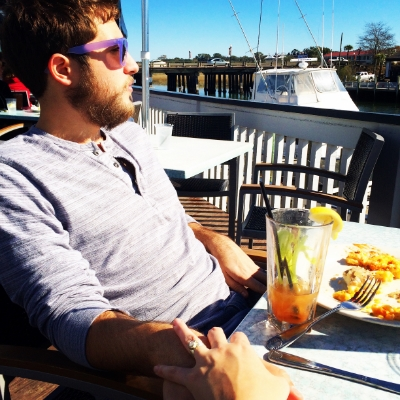 My husband, Trevor, dolphin watching on Shem Creek.
