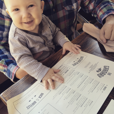 My adorable, toothless, nephew, Daemon, considering his brunch options.