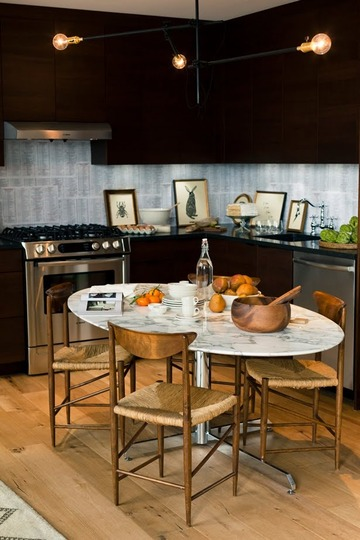 Home of Grant Gibson via Apartment Therapy - table instead of island in kitchen