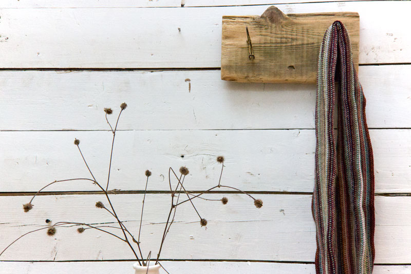 coat rack from scrap wood and dried weeds in vase