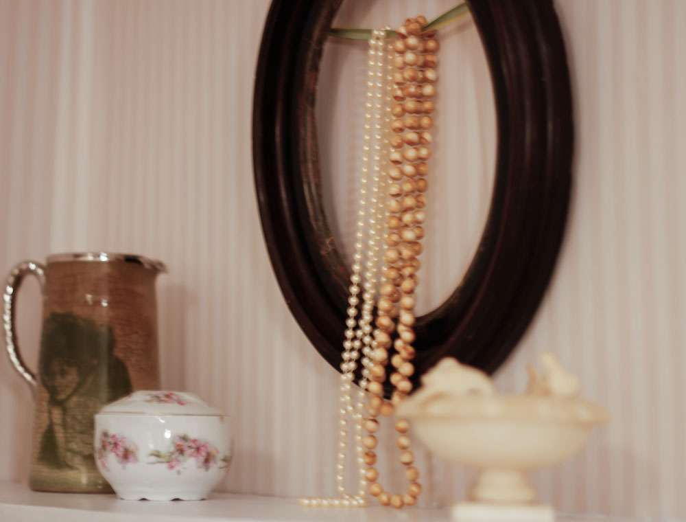 hanging jewellery on an old frame