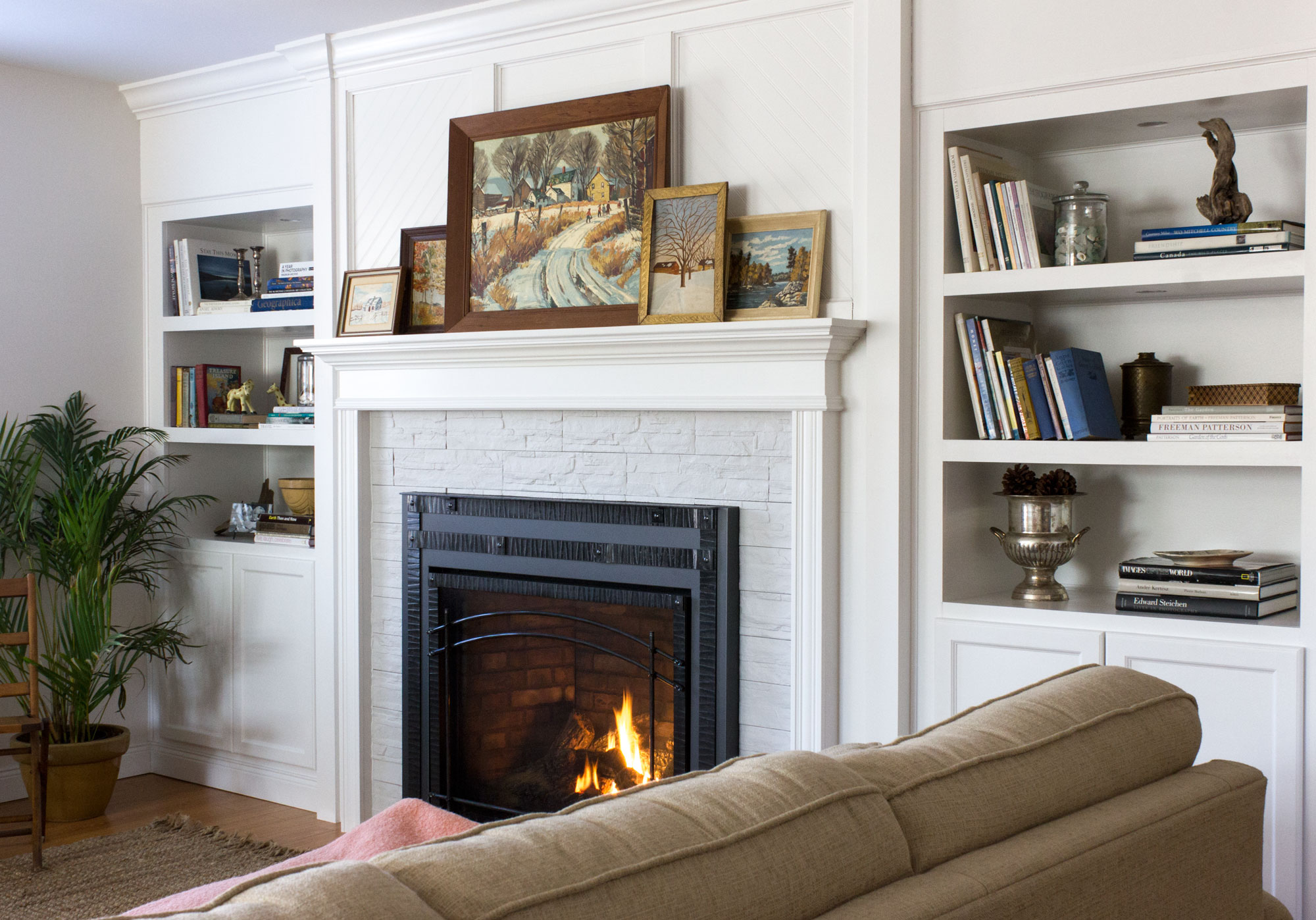 built-in bookshelves and mantle around fireplace