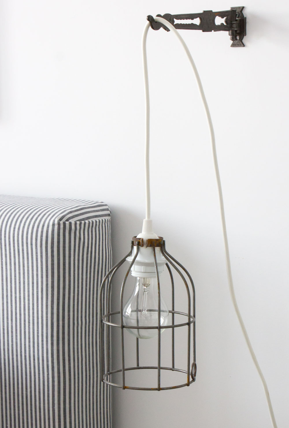 hanging-cage-light-and-reupolstered-headboard.jpg