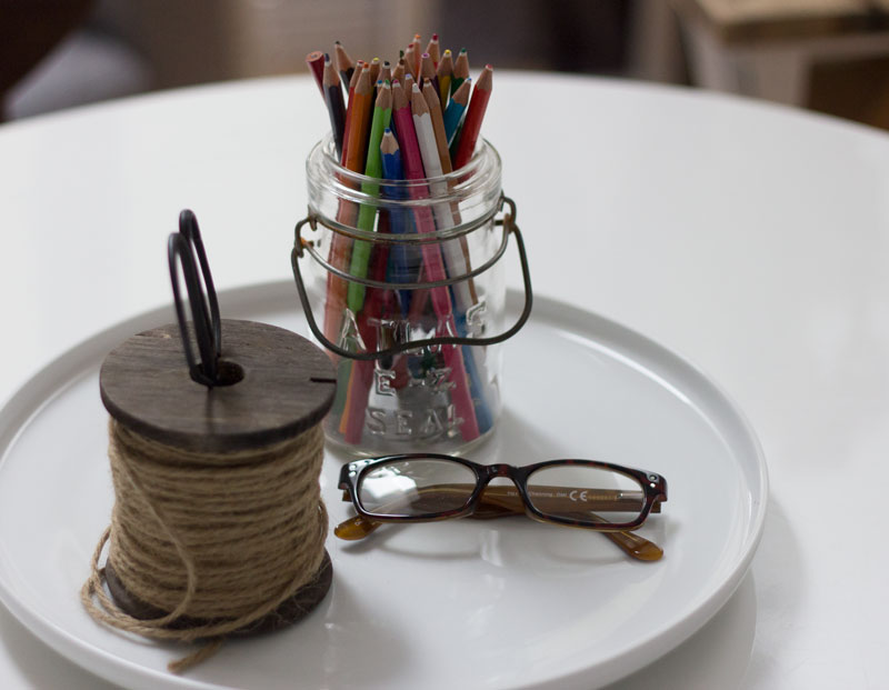 round table with craft supplies