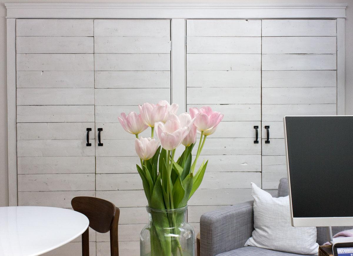 wall-of-ship-lap-closet-doors-in-office-studio.jpg