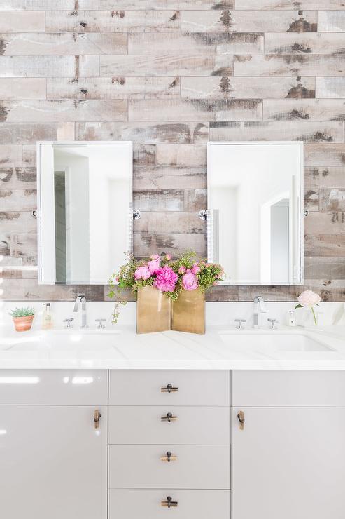 aged gray barn board wall behind bathroom vanity