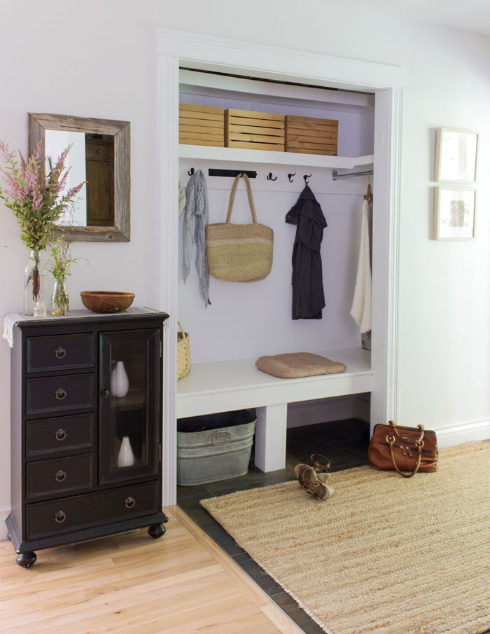 entryway using bins and crates to organize