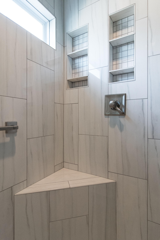 Walk-in shower, window, whisper recessed light fan, niche, shower bench, frameless glass, large format tile, Vestavia Hills, Liberty Park, Alabama, Remodel, Renovation.