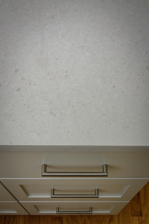 Kitchen Renovation, Kitchen Remodel, Custom Cabinets, Shaker, China White, Quartz Countertops, Undermount Sink, Herringbone Tile Backsplash, Stainless Steel Appliances, Peninsula, wood floors, Liberty Park, Vestavia Hills, Over the Mountain, Alabama.