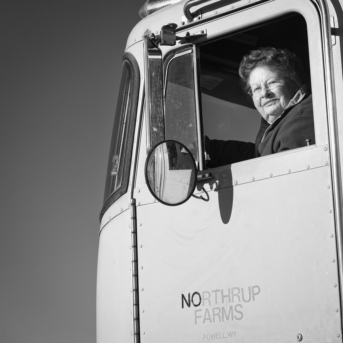 Been Here for Generations is a portrait series about generational farming families from Powell, Wyoming who still farm, and in many cases continue to live on their family's early century homestead.  Mary Ann Northrup  drives beet truck on her family's 1929 homestead.