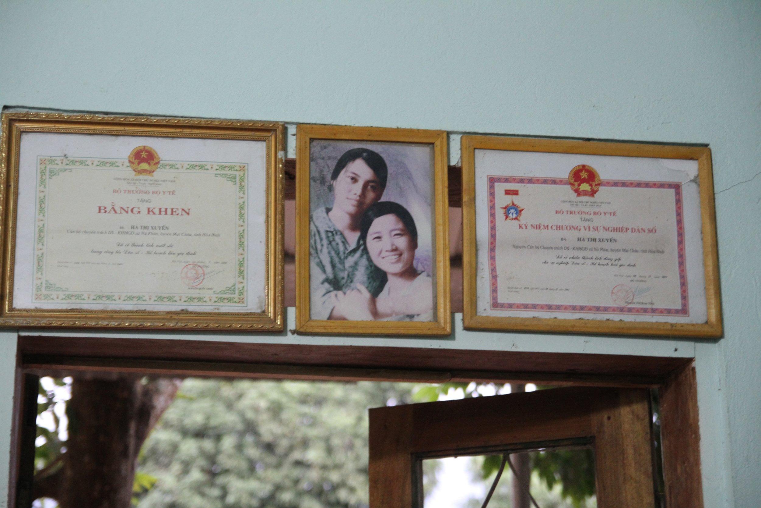 Certificates hang inside a home