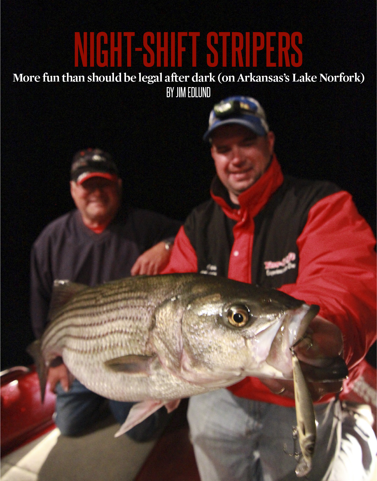 Larry Olson and Jason Mitchell with a Lake Norfork Striper.