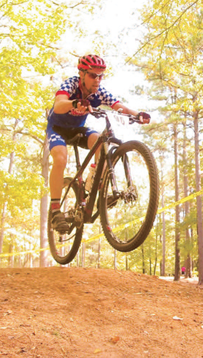 "RICHARD MACHYCEK   grew up racing and riding BMX. As a child, he dreamed of working in a bike shop. In 1992 he opened Arkansas Cycling and Fitness in Sherwood. A mountain biker, Machycek loves riding anywhere on the Ouachita Trail because it is very rocky and technical yet still has a great ""flow"" along with plenty of change in elevation. Finishing the Colorado Leadville 100 mountain bike race in under nine hours to claim the ""Under 9 Hour Gold Belt Buckle"" is his most rewarding race experience."