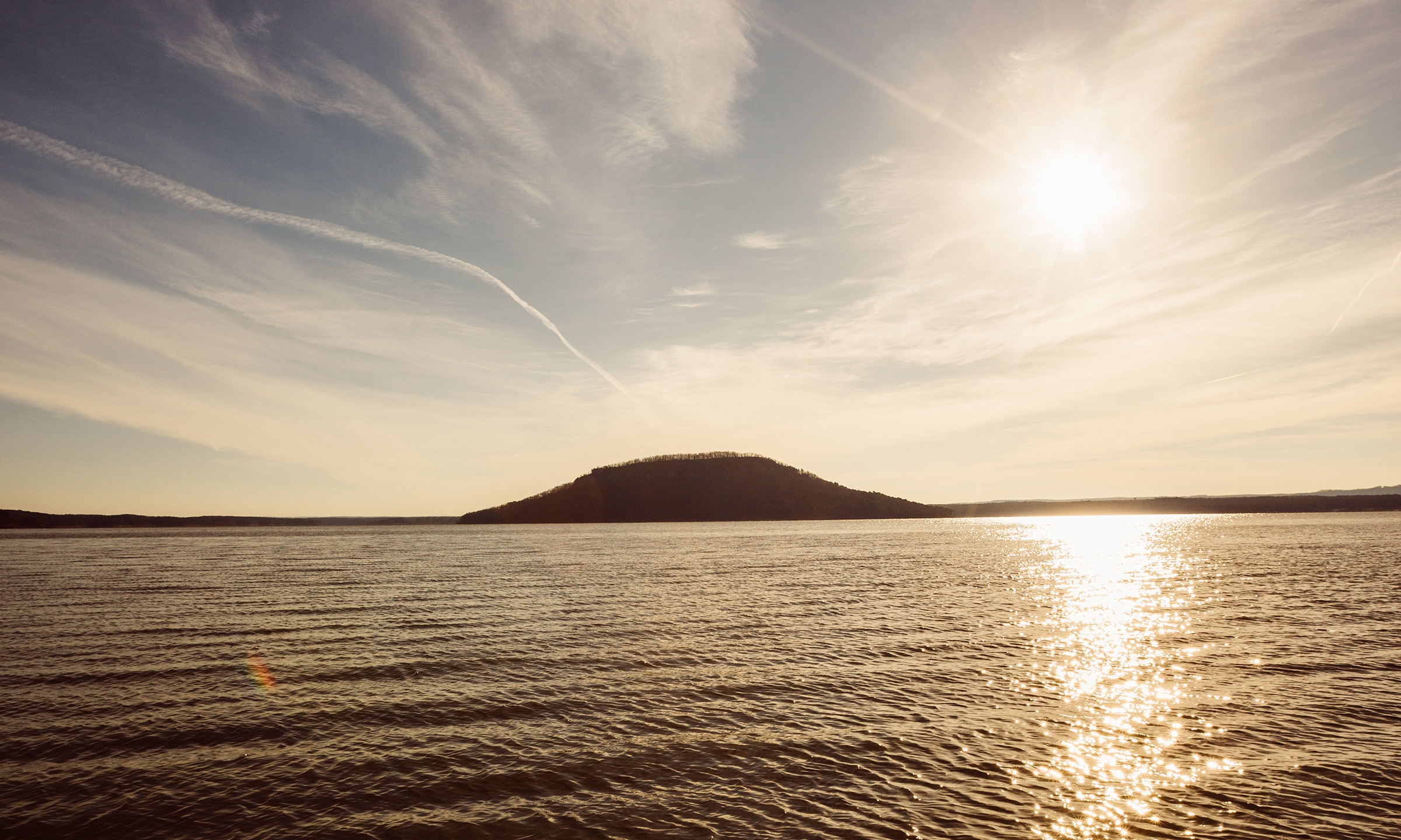 Majestic Sugar Loaf Mountain Island dominates the Greer's Ferry Lake horizon in Fairfield Bay.