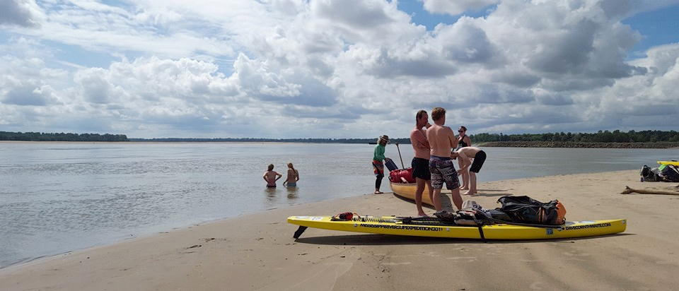 Paddlers cool off after tackling the mighty Mississippi River.