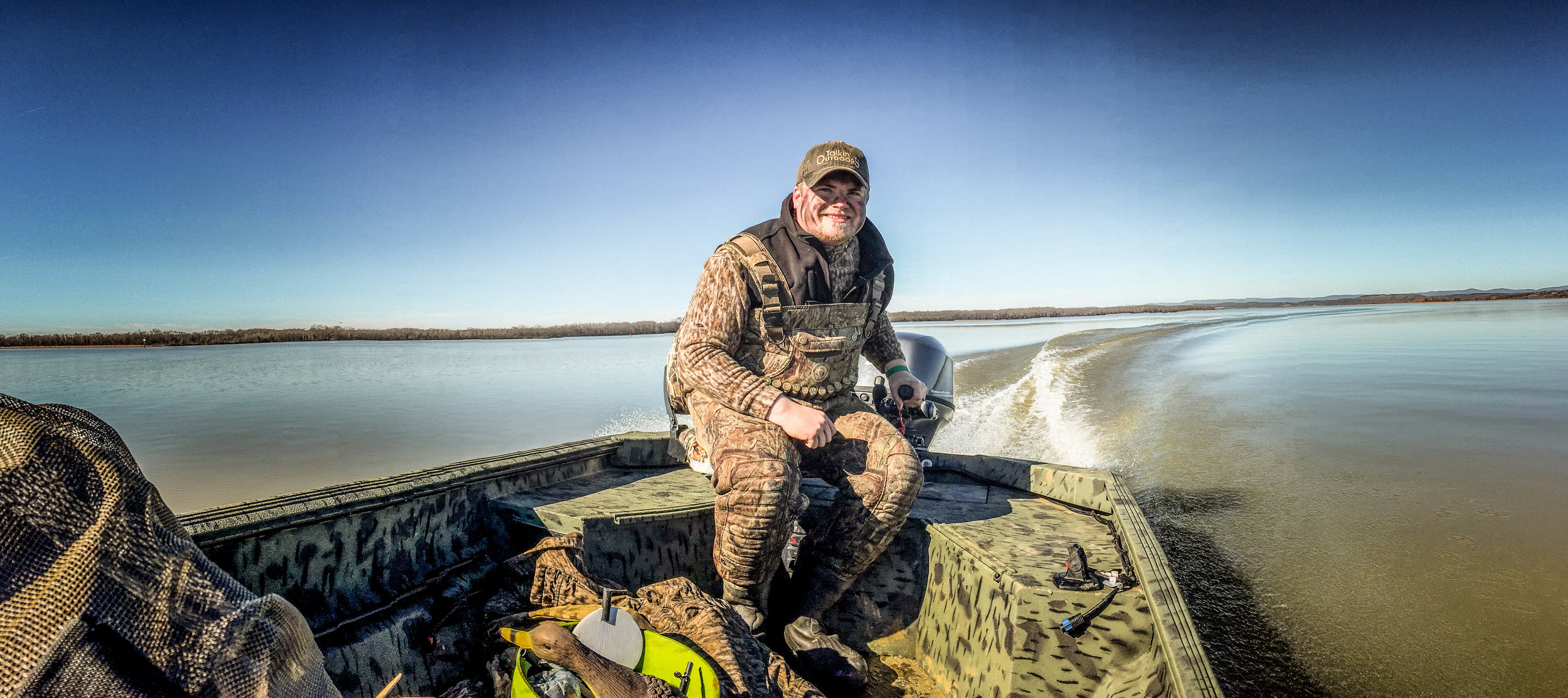 Hunter Spencer Griffith has built a lifetime's worth of friendships chasing ducks across Arkansas, from the Delta all the way up to this boat trip on Lake Dardanelle.