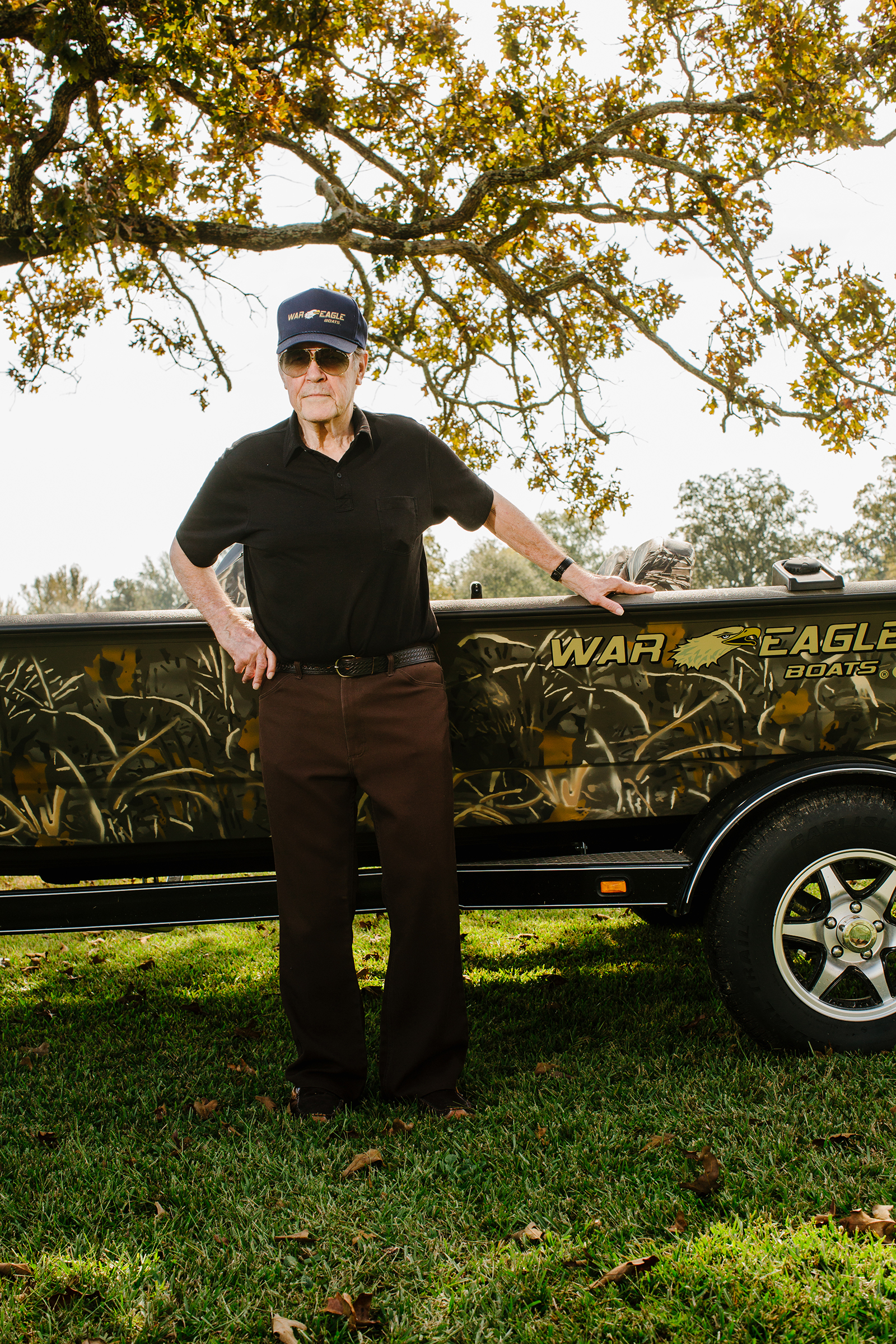Kim Ward poses with one of the War Eagle boats that bear the mark of his innovations in the aluminum boat industry.