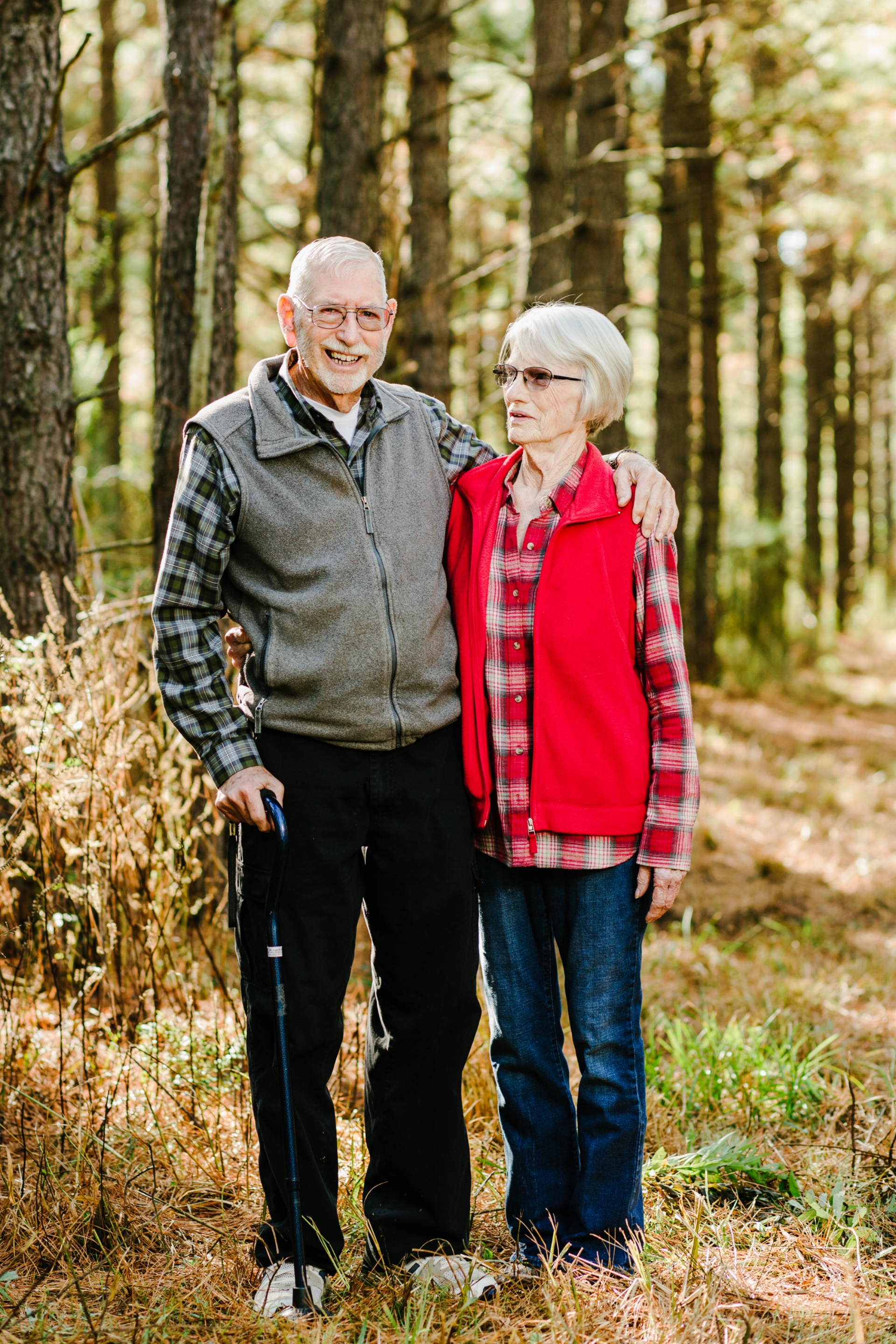 Larry and Shirley Aikman pause on a walk through their pine tree farm in Blufton.