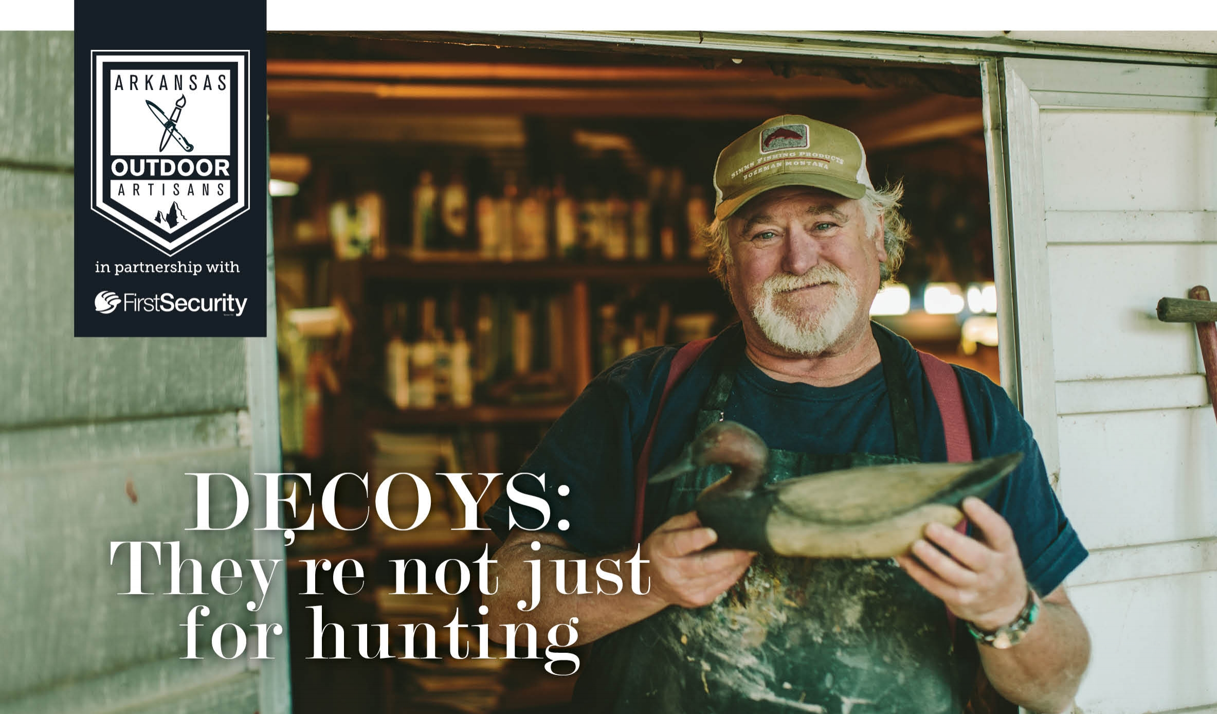 RD Wilson holds a freshly carved decoy that's been aged to look antique. Most of these wind up on a collector's mantel.