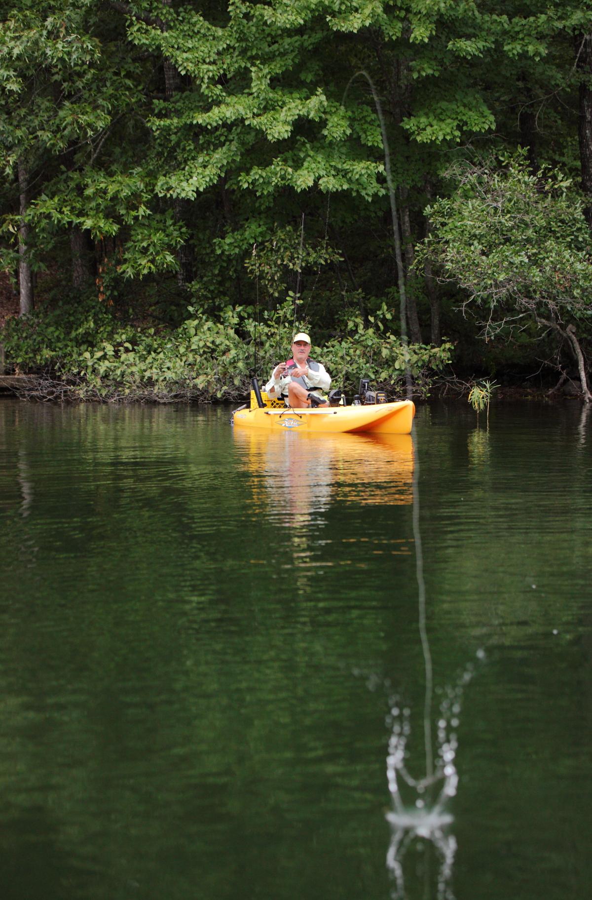 Arkansas resident Peter Trabant, avid kayak fisherman, casts his line into Lake Coronado in Hot Springs Village.